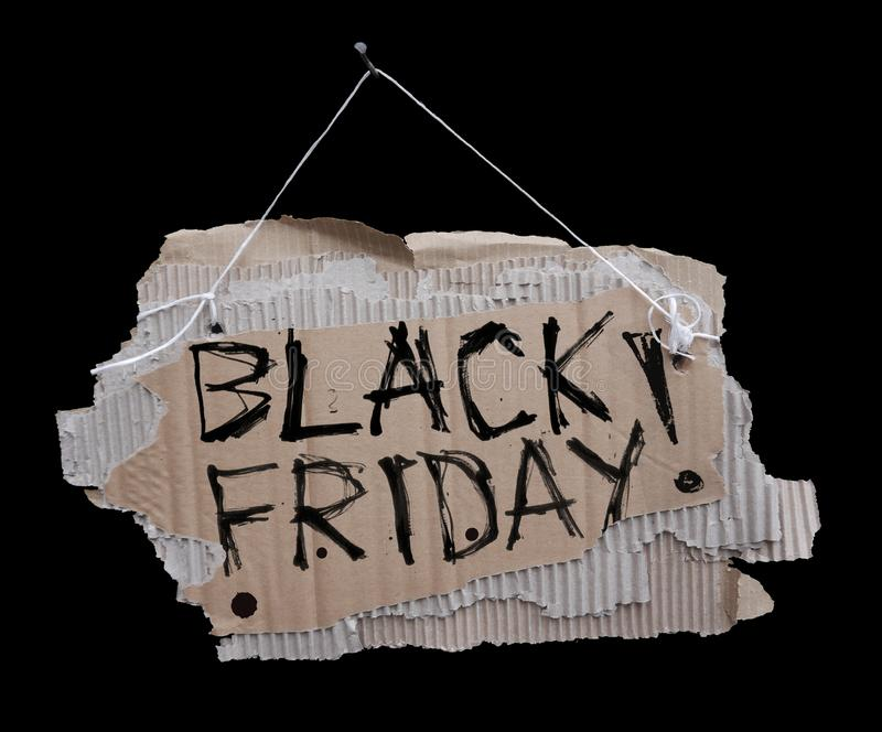 Segno del cartone su un cavo e sull'iscrizione BLACK FRIDAY fotografia stock