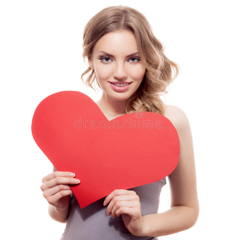 Segno del cuore di giorno di biglietti di S. Valentino della tenuta della donna fotografie stock
