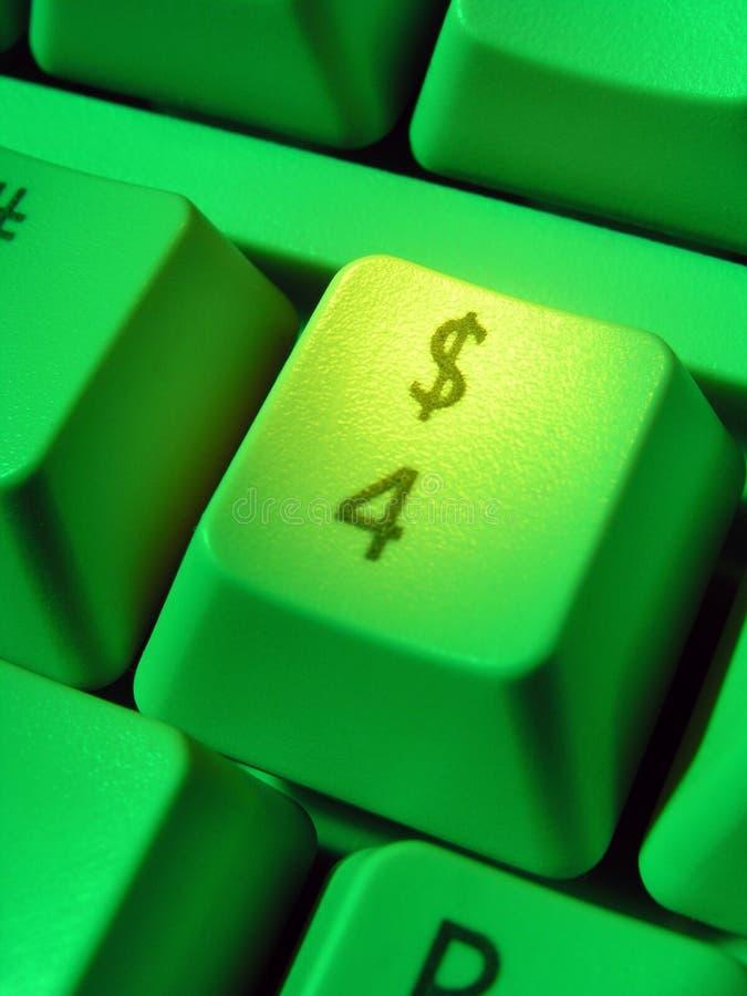 Segno del dollaro sulla tastiera di calcolatore immagini stock