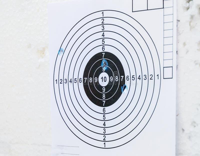 Segno di carta di colpo del foro del tiro dell'obiettivo di pratica immagine stock