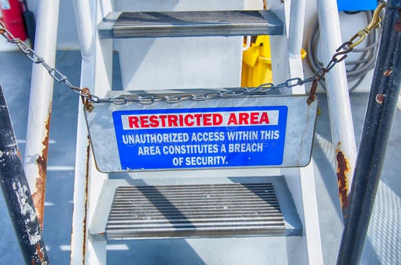 Segno di cautela, area limitata fotografia stock