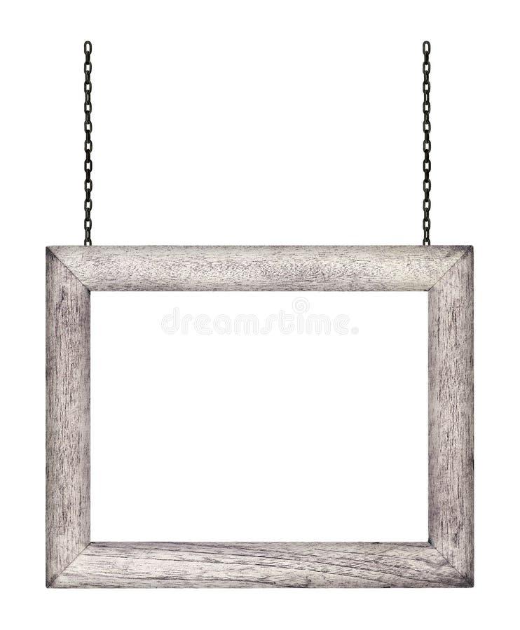 Segno di legno che appende su una catena isolata su bianco fotografia stock libera da diritti