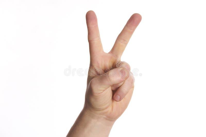 Segno di pace di gesto di mano su bianco dell'isolato fotografia stock