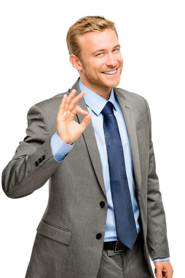 Segno felice di approvazione dell'uomo dell'uomo d'affari - ritratto su fondo bianco fotografia stock libera da diritti