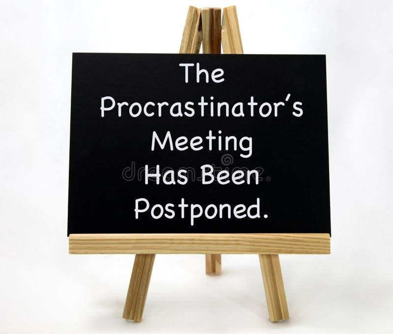 Segno posposto riunione del ` s del Procrastinator immagine stock libera da diritti