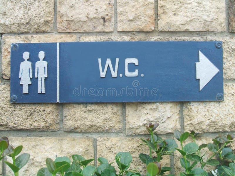 Segno unisex della toilette pubblica W C Segno della toletta pubblica immagine stock