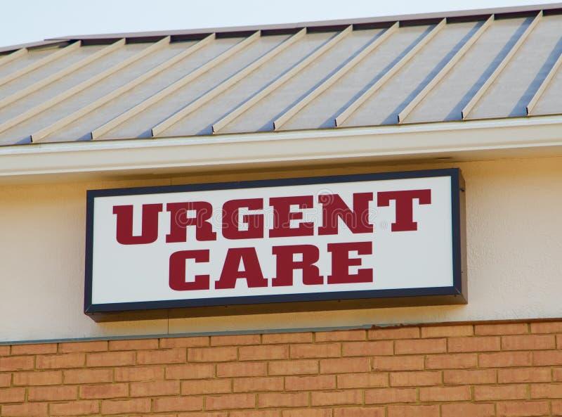 Segno urgente della clinica di cura immagini stock libere da diritti