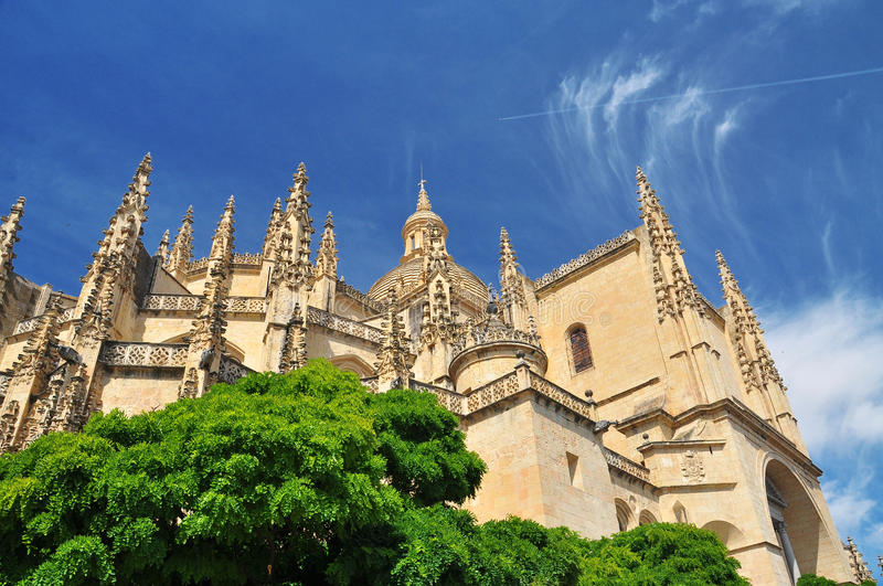 Segovia gothic cathedral. Castile, Spain. The gothic Segovia cathedral against a blue sky. Castile region, Spain royalty free stock images