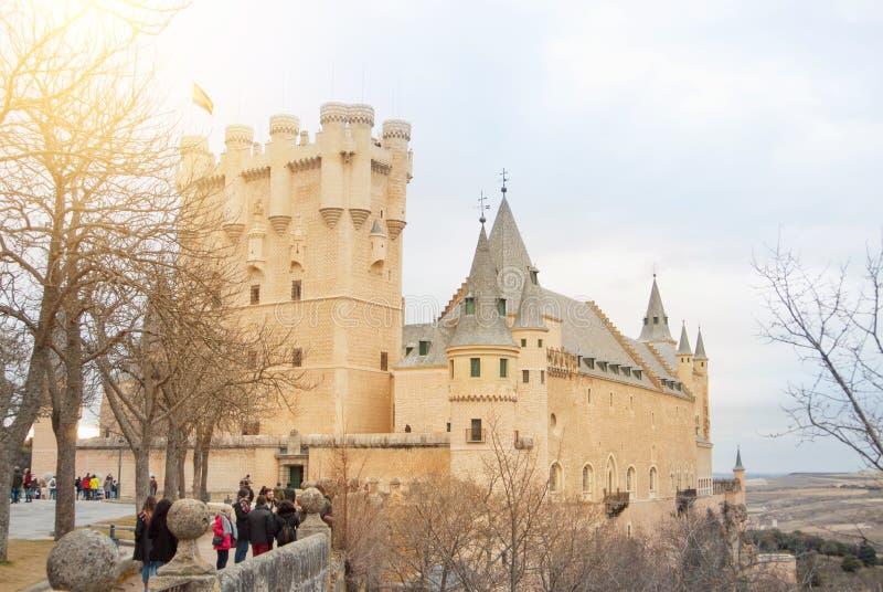 SEGOVIA, SPAIN - FEBRUARY 11, 2017: Old historical center of Segovia, Alcazar of Segovia (Segovia Fortress) and tourists stock photo