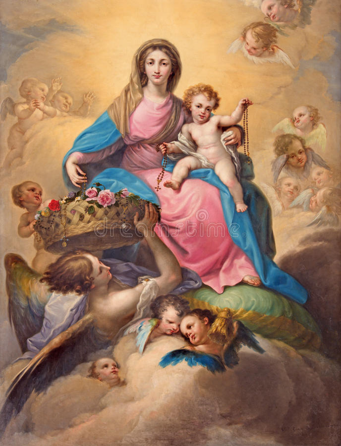 SEGOVIA, SPAIN: Painting Madonna with Child among the angels in Cathedral of Our Lady of Assumption and Chapel Our Lady of Rosary stock photos