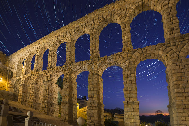 Segovia - Spain - Star Trails - Astronomy. Segovia - Astronomy - Star Trails and the Roman Aqueduct in the city of Segovia in the Castila and Leon region of stock image