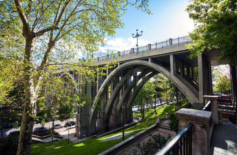 Segovia Viaduct on spring in the city of Madrid stock image