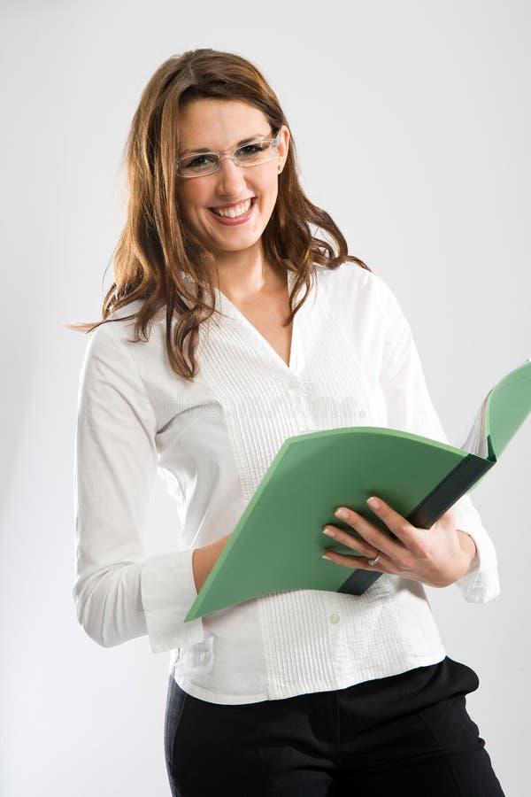 Segretaria femminile sorridente piacevole fotografia stock