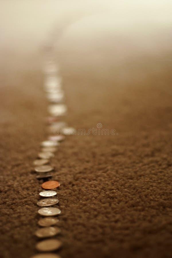 Segua i soldi fotografia stock