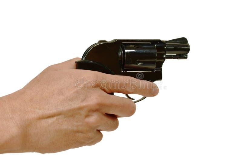 segurança da arma e do dedo do revólver da terra arrendada da mão no disparador no fundo branco imagem de stock royalty free