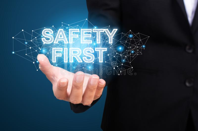 Segurança em primeiro lugar na mão do negócio Primeiro conceito da segurança imagens de stock royalty free