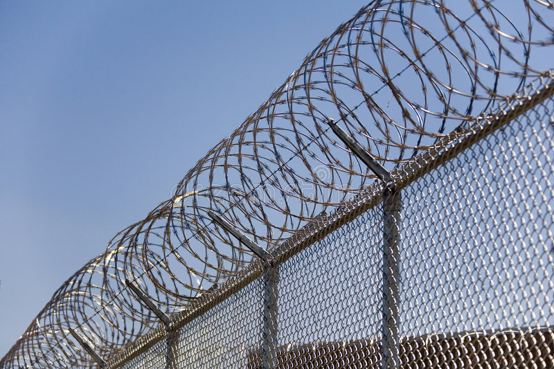 Segurança Fence_02 do fio da lâmina imagens de stock