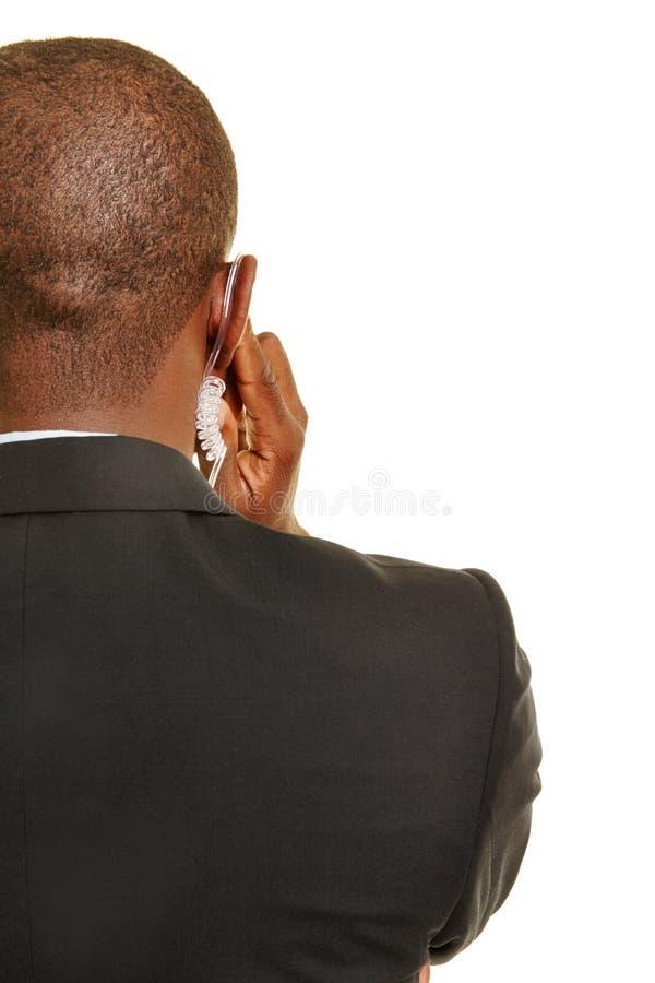 Seguridad personal de detrás con las auriculares fotos de archivo libres de regalías