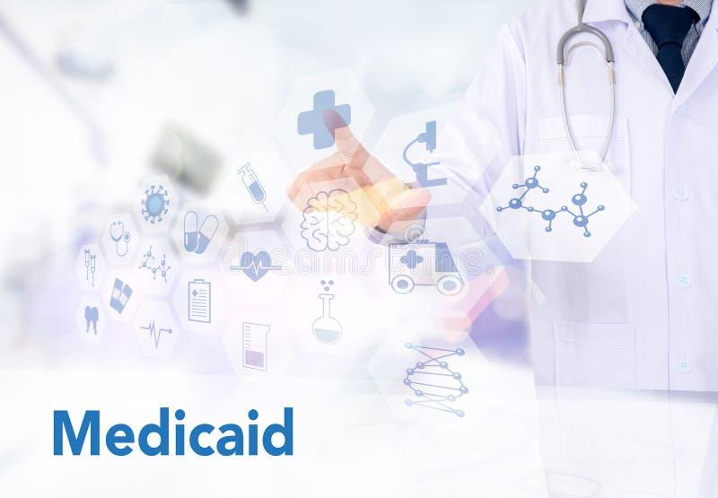 Seguro médico y Medicaid y estetoscopio imagen de archivo
