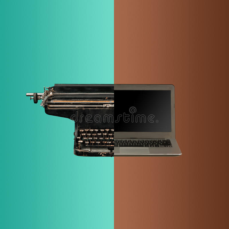 Sehr alte Modeschreibmaschine und -laptop stockbild