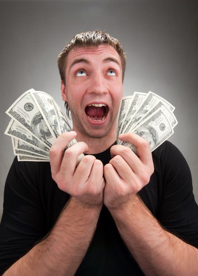 Sehr aufgeregter Mann mit Geld lizenzfreies stockfoto