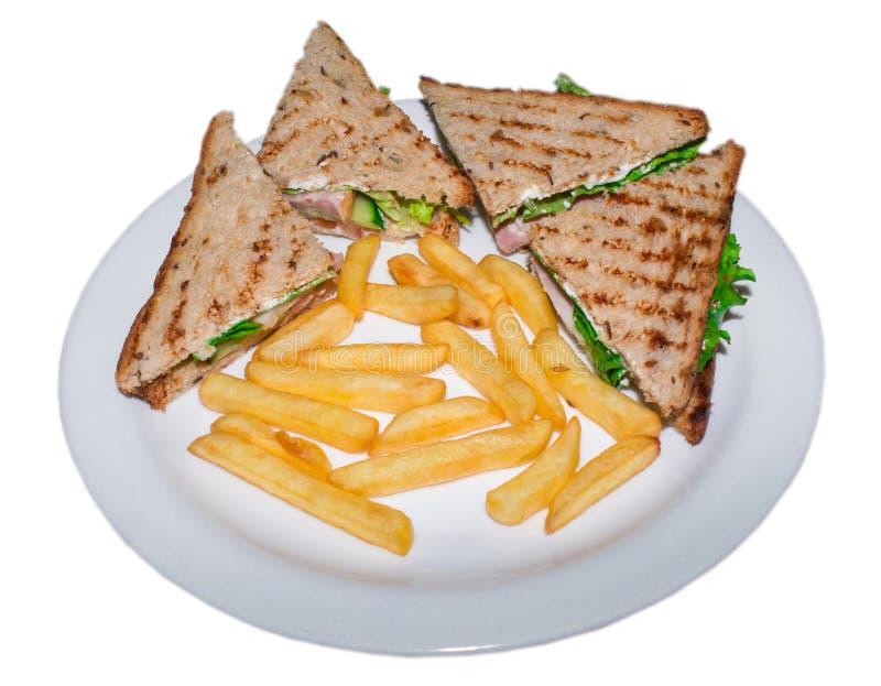 Sehr geschmackvolle belegte Brote mit Hühnerfleisch schlagen Lüge auf einer lokalisierten Platte mit einer Keule lizenzfreie stockfotos