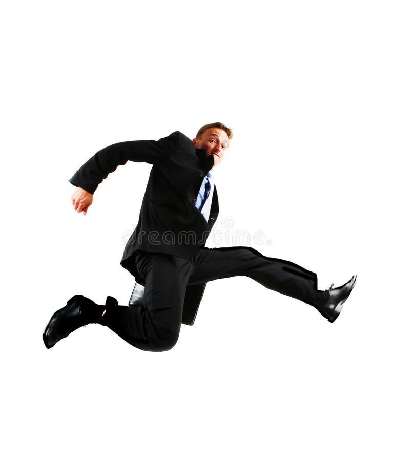 Sehr glücklicher Energiegeschäftsmann, der in springt stockbild