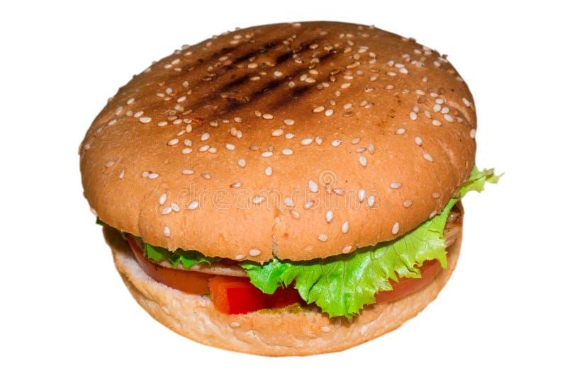 Sehr köstlicher saftiger Burger auf einem weißen Hintergrund lokalisiert lizenzfreie stockbilder