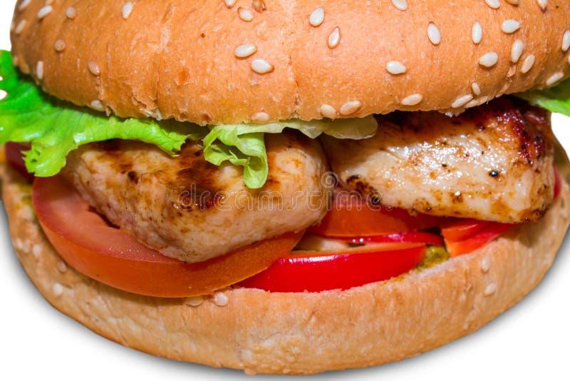 Sehr köstlicher saftiger Burger auf einem weißen Hintergrund lokalisiert lizenzfreie stockfotografie