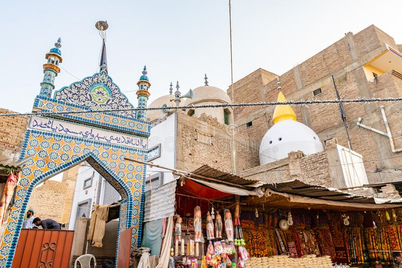 Sehwan Sharif Common Street 03. Sehwan Sharif Common Street Picturesque View of a Mausoleum During Eid Al Fitr on a Sunny Blue Sky Day stock photography