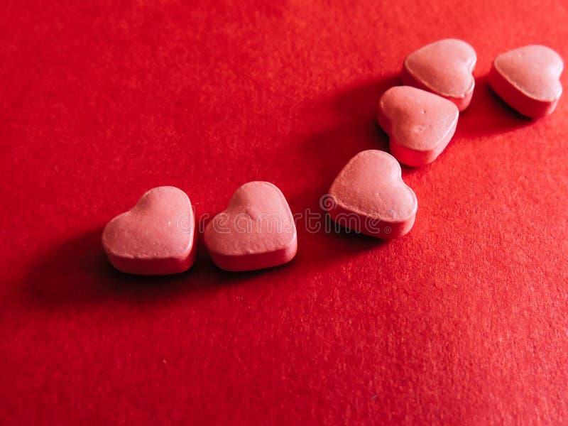 Sei compresse del cuore Rosa rossa immagine stock