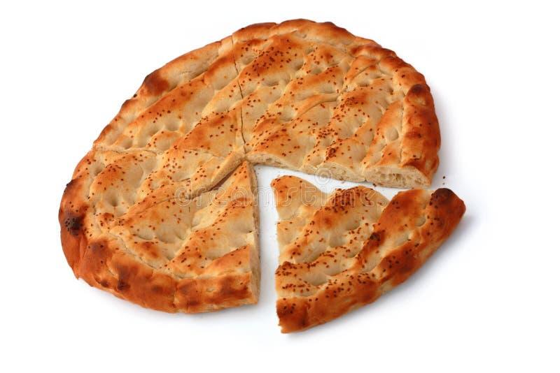 Sei hanno diviso il pane di pita delle fette isolato su bianco fotografia stock
