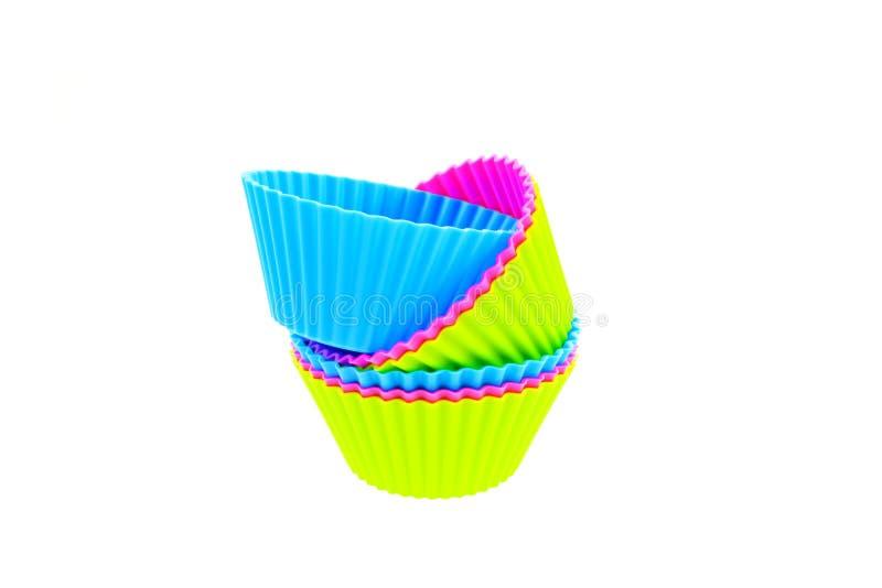 Sei vaschette multicolori della focaccina del silicone fotografia stock libera da diritti