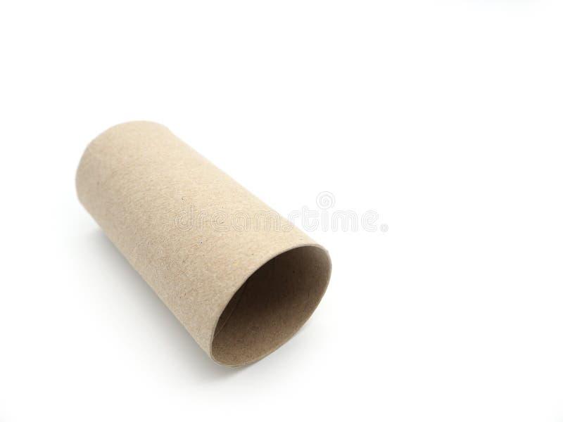 Seidenpapierrollenkern Leeren Sie Rolle auf dem Toilettenpapier, das auf a lokalisiert wird lizenzfreies stockfoto