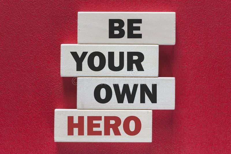 Seien Sie Ihr eigener Held Motivmitteilung stockbild