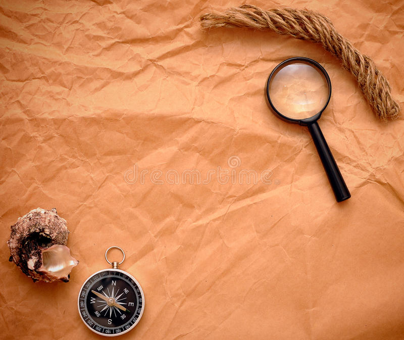 Seil, Kompaß und Lupe lizenzfreies stockfoto