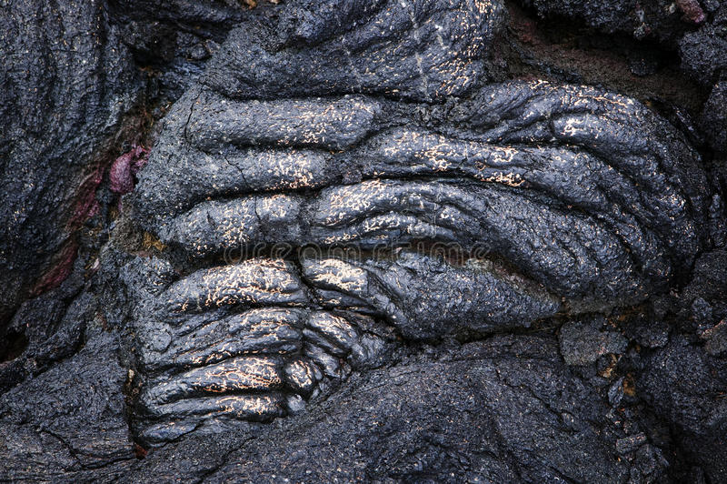 Seil-Lava-Detail mit Gold, Hawaii lizenzfreie stockbilder