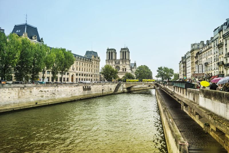 Seine river and main Facade of Notre Dame de Paris Cathedral, Paris, France, Europe royalty free stock photos