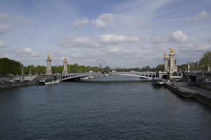 Seine River Paris and Pont Alexandre III bridge. Pont Alexandre III is largely regarded as the most beautiful bridge in the city stock images