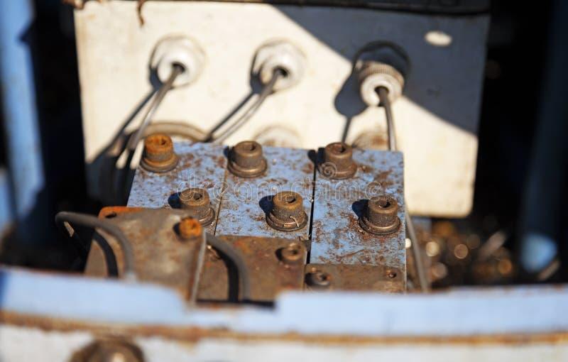 Seis grandes parafusos e três furos para cabos imagens de stock royalty free