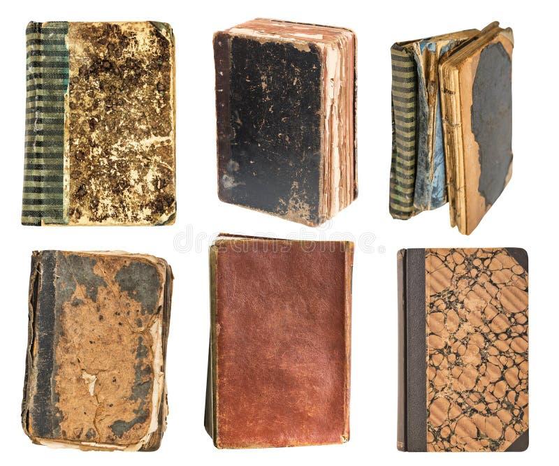 Seis livros muito velhos do vintage isolados no fundo branco Biblioteca velha imagem de stock royalty free