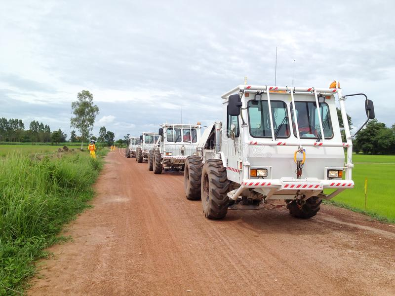 Seismic vibrator trucks vibroseis shooting for land seismic survey for oil and gas exploration. In Thailand royalty free stock photography