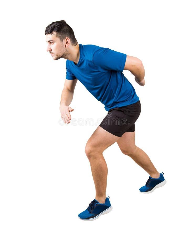 Seitenansicht in voller Länge von entschlossener kaukasischer Mannläuferstellung in der Laufposition, die nach vorn überzeugt sch stockfoto