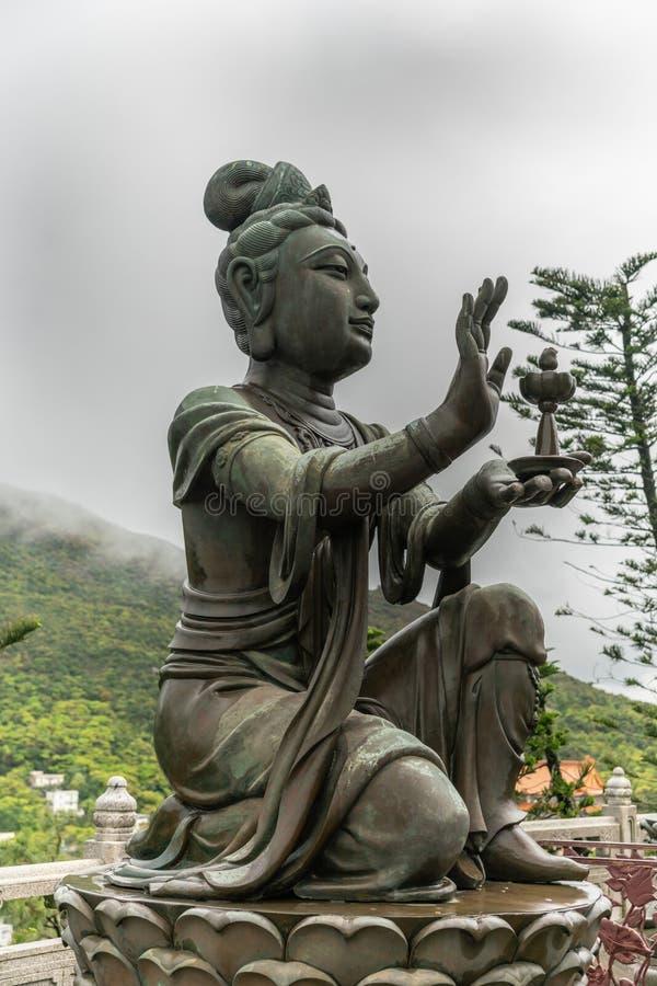 Seitennahaufnahme, eine des sechs Devas, das Tian Tan Buddha, Hong Kong China anbietet stockfotos