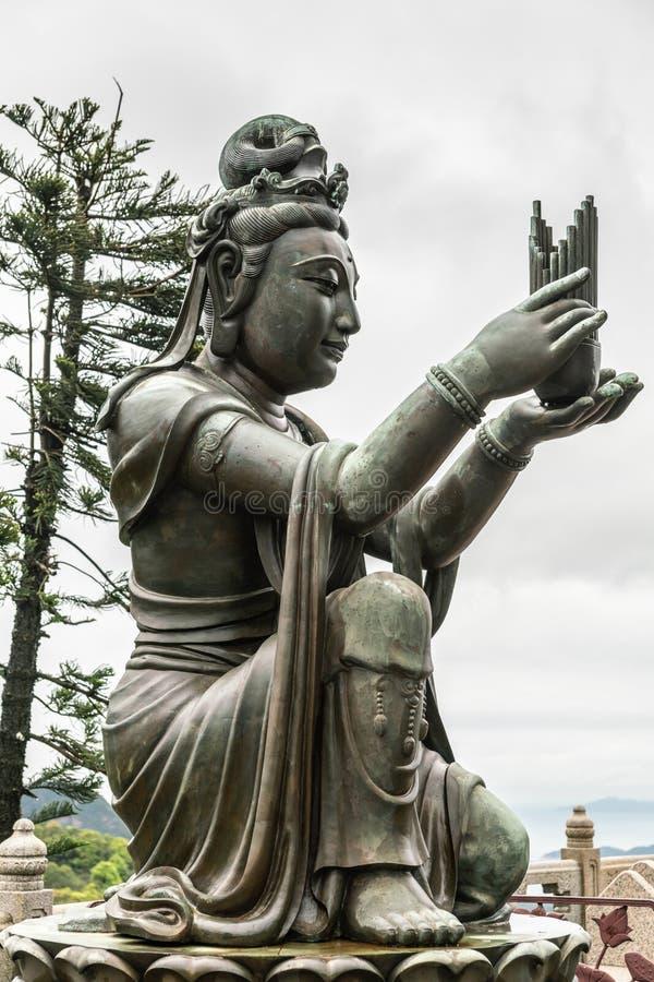 Seitennahaufnahme, eine des sechs Devas, das Tian Tan Buddha, Hong Kong China anbietet stockbilder