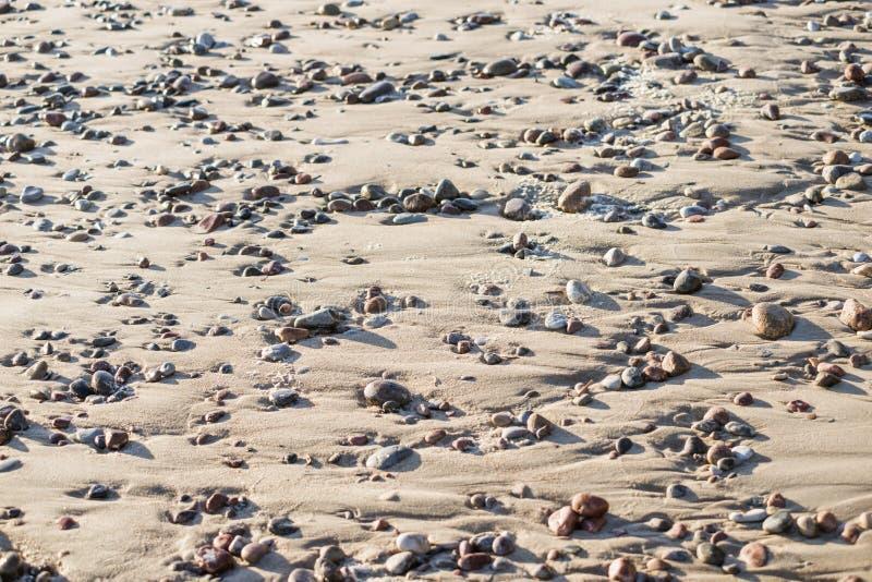 Seixos da praia da areia imagem de stock royalty free