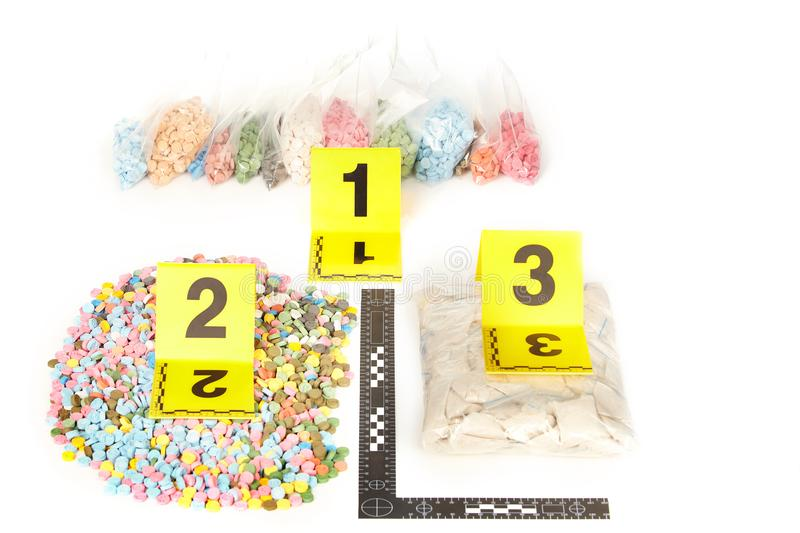 Seized pills of extasy contraband found by legal authorities during search warrant. Seized pills of extasy contraband found by legal authorities stock photos