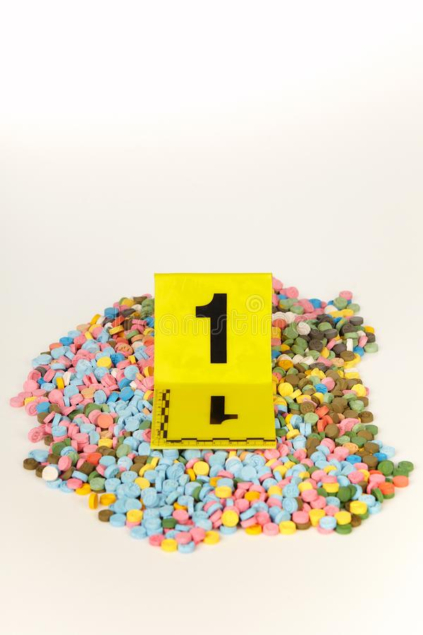 Seized pills of extasy contraband found by legal authorities during search warrant. Seized pills of extasy contraband found by legal authorities royalty free stock photos