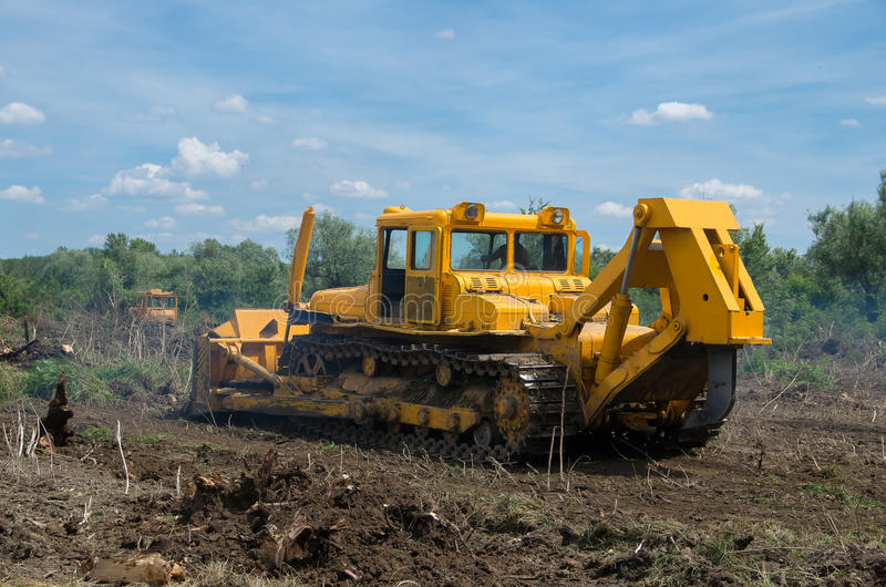 Seizure of forest land for agriculture. Destruction of forests with bulldozer. Destruction of forests with bulldozer. Seizure of forest land for agriculture stock image