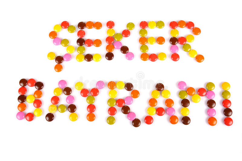 Seker Bayrami words written by colorful candy beans. Seker Bayrami means Candy Festival in Turkish language. Candy Festival is traditional festival in Turkey and royalty free stock photos